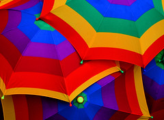 Carnaval Umbrellas (Andrea Kennard) Tags: travel carnival blue light red party summer sun white holiday storm abstract green london art nature wet water beautiful lines rain weather yellow umbrella season design daylight spring rainbow colours natural bright background curves rainy cover parasol shield thunderstorm concept lush shelter multicolored protection brolly forecast multicolour elephantandcastle burgesspark platinumheartaward carnavaldepueblo