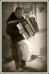 the accordian player, manchester (Broady - social documentary) Tags: uk england people bw music sepia manchester mono streetphotography piccadilly beggar busker accordian immigrant accordianplayer broady passionphotography muscisian stephenbroadhurst