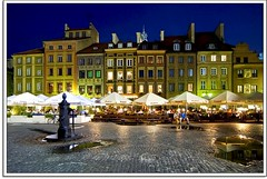 The Bright Lights of Warsaw (Nathan Bergeron Photography) Tags: blue windows people colour fountain architecture night buildings reflections square geotagged lights interestingness artist nightlights market poland tourists unesco worldheritagesite cobblestones patio getty warsaw bluehour parkbench puddles oldtown picks easterneurope warszawa centra