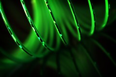 slink:  289/365 (helen sotiriadis) Tags: abstract black macro reflection green closeup canon toy spring published dof bokeh depthoffield slinky tilt canonef100mmf28macrousm canoneos40d toomanytribbles