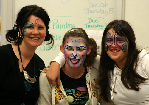 Michelle Silver, Mackenzie Cameron and Megan Nault model the face painting done by Michelle.