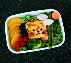 Tiger Bento (sherimiya ) Tags: school cute face fruit lunch kid sweet tiger sheri plum broccoli potato asparagus vegetarian bento raspberries blackberries ravioli obento peapods sherimiya