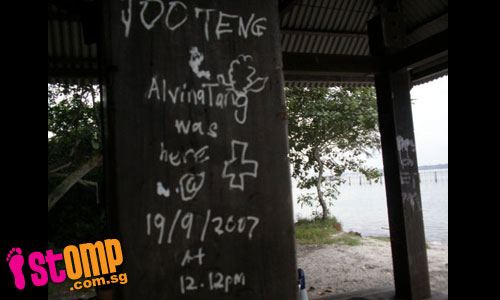 Picnickers burn hole in bench at Pulau Ubin