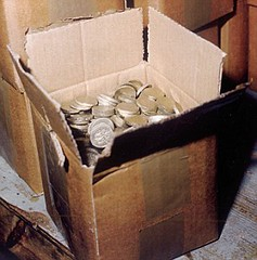 Pound coin counterfeit boxes of coin