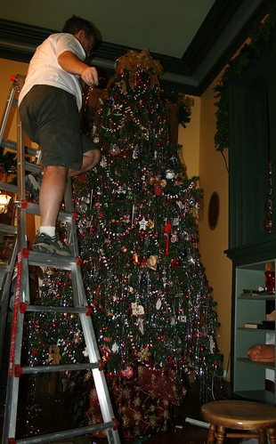 tinseling the top of the tree