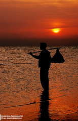 'm looking for my lost home (Nooh Essa) Tags: sea orange cloud sun beach home silhouette sunrise lost for looking cloudy away far
