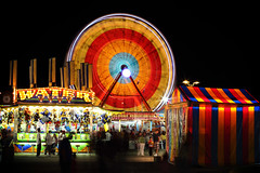 Carnival Midway (Todd Klassy) Tags: county city longexposure carnival people urban motion black color art water beautiful wheel sign horizontal wisconsin kids youth night booth dark circle children outdoors lights evening tents movement ride mechanical time statefair july fair ferris games flags illuminated entertainment nighttime madison spinning ferriswheel rides midway summerfun countyfair adults 4h wi atnight enjoyment fayre summernights urbanlandscape darksky madisonwisconsin havingfun urbanlife carnivalrides stockphotography elapsed blacksky summercarnival colorimage danecountyfair underthestars peoplehavingfun wheelinthesky carnivalmidway carnivalgoers travelingshow summerinwisconsin movingferriswheel ridingaferrishwheel