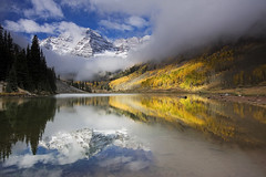 Maroon Bells - Magic Morning (Sandra OTR) Tags: autumn sunset cliff sun mountain lake mountains cold reflection fall texture water glass colors yellow rock fog bells still colorado rocks moody maroon smooth rocky peaceful atmosphere calm hillside placid colorphotoaward winnr alemdagqualityonlyclub