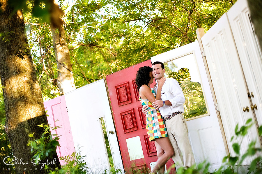 bride and groom portrait at wedding rehearsal dinner red pink and white doors