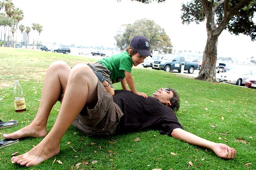 Joaquin wrestling Dan at the park