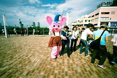 my new pink best friend (troutfactory) Tags: pink bunny film strange japan tokyo weird costume crazy funny voigtlander surreal rangefinder wideangle mascot   odaiba analogue superia400 creature 15mm bessal kooky heliar  itsmyunreality