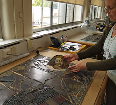 o. Placing the glass on the template rubbing.