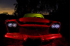 Hooded Eyes (Lost America) Tags: lightpainting abandoned night fullmoon 1958 junkyard chrysler nocturnes thebigm