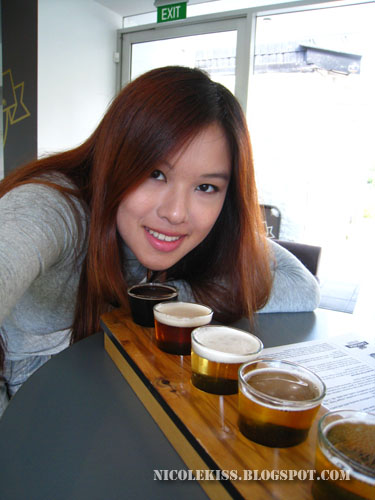 posing with beer tasting set