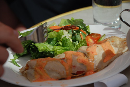 greens and a roasted red pepper - chevre crepe