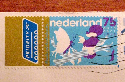 Dutch gnome with butterfly stamp