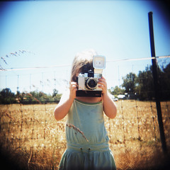 (Rikki  B) Tags: camera portrait sky film girl field holga lomo xpro crossprocessed dress country diana vignette feild kodakektachromee100vs mediumformatfilm epsonv700scanner