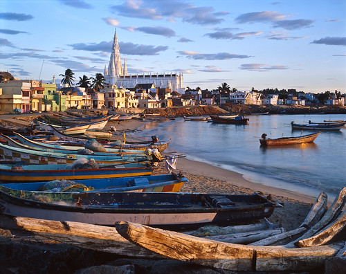 A small fishing village at Kanya Kumari, India, with fishermen's catamarans lined up on the beach