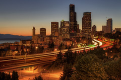 Seattle Downtown Skyline from Dr Jose Rizal Bridge at Dusk - HDR (David Gn Photography) Tags: road seattle city travel blue light sunset sky cars skyline night buildings evening washington highway downtown cityscape skyscrapers traffic dusk trails landmark clear hour freeway sound hdr puget 3xp flickraward platinumheartaward canoneos7d platinumpeaceaward sigma2470mmf28ifexdghsm mygearandme mygearandmepremium sigma50th