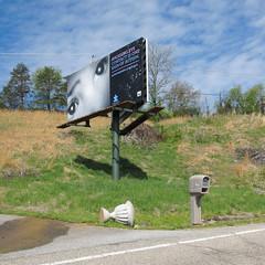West Virginia roadside autism education. (Tim Kiser) Tags: 2015 20150427 adcouncil advertisingcouncil april april2015 autismspeaks countyroad1444 img4798 midohiovalley mineralwells mineralwellswestvirginia mineralwellslandscape parkersburgmetropolitanarea parkersburgmarietta pikestreet westvirginia westvirginialandscape woodcounty woodcountywestvirginia woodcountylandscape autismawareness autismawarenessadvertisement autismspeaksorg avoidingeyecontact billboard blackandwhitephotography childseyes doublebillboard electriclines embankment eyes grasses grassyembankment landscape mailbox overheadelectriclines overheadpowerlines overturnedplantcontainer overturnedplanter partlycloudy paved pavement plantcontainer planter plasticmailbox powerlines publicserviceadvertisment road roadside roadsideembankment roadsidelandscape signsofautism suburbanparkersburg tippedoverplantcontainer tippedoverplanter wetpavement whitestripe unitedstates