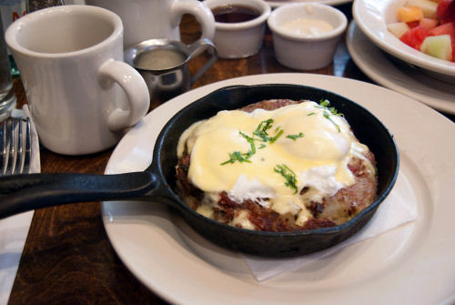 A pan of read corned beef hash from Nonna in the UWS