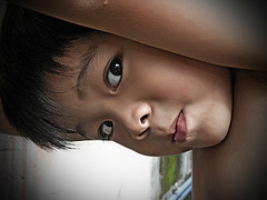 Peek (Gilbert Rondilla) Tags: camera boy portrait people color cute male face up horizontal closeup kids photoshop children point asian photography photo kid nikon shoot child close faces philippines adorable gilbert filipino peek digicam notmycamera own pinoy offspring s10 adik borrowedcamera pns rondilla notmyowncamera gilbertrondilla gilbertrondillaphotography luisianian gettyimagesphilippinesq1