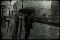 November days (Che-burashka) Tags: november man london westminster rain sign umbrella dark underground walking mywebsite 400d