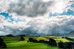 Thunder Over Ruahine (Mark Solly (F-StopNinja)) Tags: sky cloud sun storm weather shadows farm front land rays nikond90 tamron18270mm