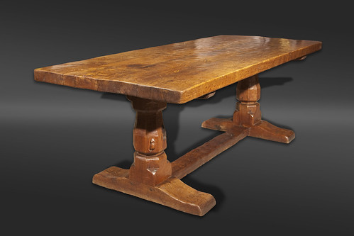 An oak refectory table by Robert Thompson of Kilburn, better known as The Mouseman