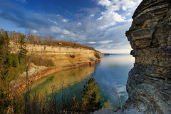 """""""Miners Castle""""   Pictured Rocks National Lakeshore - Munising , Michigan (Michigan Nut) Tags: blue usa beach fog clouds landscape geotagged cove wideangle greatlakes coastline lakesuperior picturedrocksnationallakeshore algercounty hikingmichigan nikon1635mmf4gedafsvrwideanglezoomlens minerscastlepicturedrocksnationallakeshore"""