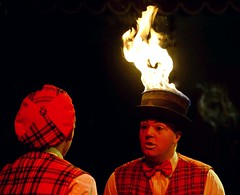 I feel a bit feverish... (Breboen) Tags: c clown circus hat hot fire head red flame fun tar tartan chat show weird fever heath bowtie makeup burn black tophat explore barones performance artist entertainment laugh