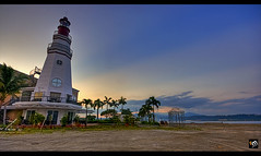 The Marina Resort Lighthouse ([ Rodelicious ]) Tags: ocean trip travel blue light sea vacation sky plants sun plant seascape color colour reflection art beach nature beautiful beauty smile clouds contrast photoshop sunrise canon landscape geotagged photography photo rocks exposure dof photos philippines pk subic canoneos hdr highdynamicrange hdri blending waterscape rodel zambales sigma1020mm panoramicview mabuhay photomatix tonemap canon400d canonxti colorphotoaward aplusphoto pinoykodakero colourartaward perfectescapes rodelicious ifolio garbongbisaya marinaresortlighthouse rodeljoselitomanabat gettyimagesphilippinesq1 gettyimagesasia gettyimagesphilippines