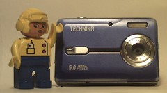 My Technika 5MP Camera! (The Chairman 8) Tags: camera blue white hat yellow digital silver lens words lego goggles plastic figure digitalcamera pixels mega duplo 5mp megapixels technika 5megapixels fivemegapixels