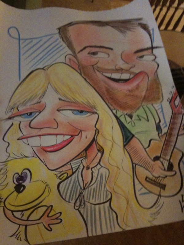A girl, a boy, a giant yellow monkey and a guitar.