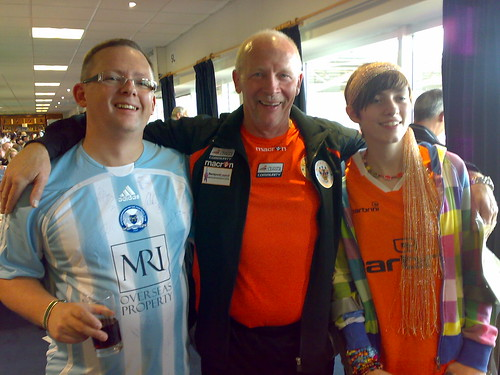 Hannah with Derek Spence of Blackpool FC and Posh mascot Paul Myland