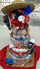nautical themed diaper cake for twins (cherries and chives-zaheera badat) Tags: wood blue red baby white net cake shower engagement bucket shoes designer navy diaper gift blanket displays nautical receiver onesies trays spade bibs grower zaheera badat cherries chives
