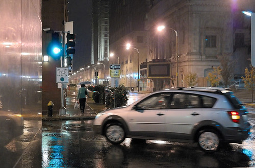 Downtown Saint Louis, Missouri, USA - turning car at night in the rain