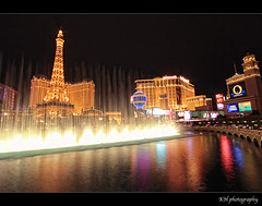 La vie en rose (kennymuz) Tags: show lake paris france water fountain night french hotel colorful shot lasvegas eiffeltower dream casino bellagio 1022mm blvd louisarmstrong lavieenrose canoneos50d kennymuz 2exposuredri kenthung