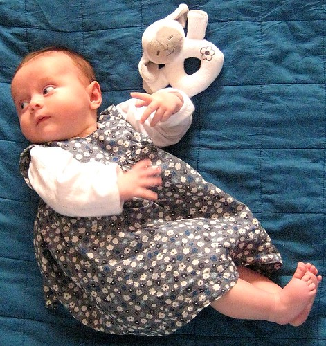 baby in Coudre kleedje