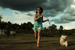 (L. Garrett, Photos) Tags: blue sky dog storm girl grass childhood digital hair child wind bell katie run skirt leash charliethepup