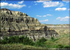 The Badlands, Tolman Bridge, Alberta, Canada (westrock-bob) Tags: bridge blue light summer sky white canada color green colors grass stone clouds fence wire sand sandstone shadows bad bob dry ab canadian alberta valley land barbed 2009 arid allrightsreserved westrock canadien kanada tolman kanata fertile badland cuthill aplusphoto trochu westrockbob vosplusbellesphotos bobcuthillphotographygmailcom