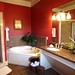 "Master Bath in the Presidential Suite at the Foundry Park Inn & Spa<br /><span style=""font-size:0.8em;"">The 1,200 square foot Foundry Presidential suite is our  finest accommodation for the most discriminating guests. Brimming with Southern charm, gracious luxury and sweeping expanses, this suite is designed to make guests feel instantly at home. A dining table for six encourages lingering meals, conversational seating prompts memories to be made. The guest room has two queen beds and a full bath with granite countertops and a soaking tub. The master bedroom invites you to sink into the four poster bed and wile away your afternoon. The master bath is luxuriously appointed with granite countertops, a soaking tub and a steam shower.</span> • <a style=""font-size:0.8em;"" href=""http://www.flickr.com/photos/40929849@N08/3962850921/"" target=""_blank"">View on Flickr</a>"