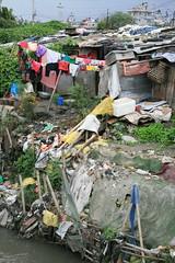 Kathmandu's Worst Living Conditions (ellievanhoutte) Tags: poverty city nepal urban home trash river living kathmandu clotheslines slum dwelling bagmati