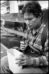 "blind singer - Bangkok, city of angels (Sailing ""Footprints: Real to Reel"" (Ronn ashore)) Tags: life street people blackandwhite man male film portraits chinatown faces blind rangefinder singer busking blindness leicam4 fujineopan1600800 leicasummicron35mmf2iv bangkokcityofangels 2009dec086004m4leicasummicron35mmf2ivfujineopan1600800"