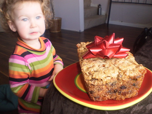 Toddler eyes the fruitcake with trepidation