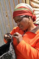 Crochet (Lauren Barkume) Tags: africa portrait orange woman black st metal rural port southafrica tin photography african crochet plastic shack johns easterncape headwrap khosa pondo portstjohns aidtoartisans atasa laurenbarkume