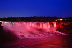 Niagara Falls at Night (Philipp Klinger Photography) Tags: new york trip travel pink blue light red vacation sky usa ny ontario canada motion art fall water rock night america river geotagged lights us long exposure nocturnal unitedstates state united unitedstatesofamerica illumination niagara falls explore american hour empire states amerika frontpage kanada on of