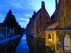 Bruges (Che-burashka) Tags: old travel sky reflection building water architecture boats boat canal europe belgium postcard brugge medieval bruges bluehour medievaltimes sx twilights