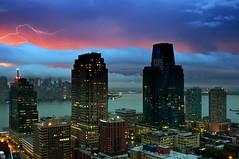 Lightning (mudpig) Tags: nyc newyorkcity longexposure storm fog sunrise geotagged dawn jerseycity manhattan batterypark hudsonriver thunderstorm thunder goldmansachs mudpig stevekelley