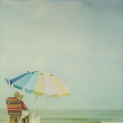 Mimi on the beach (IrenaS) Tags: ocean sea summer woman beach hat umbrella polaroid chair pastel assateague artlibres